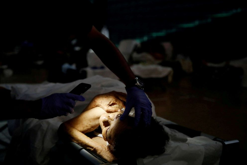 PHOTO: A doctor checks the eyes of Hilda Colon at a shelter set up at the Pedrin Zorrilla coliseum after the area was hit by Hurricane Maria in San Juan, Puerto Rico, Sept. 25, 2017.