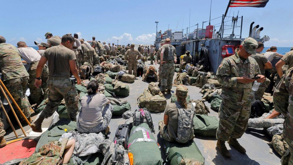 The deck of a U.S. Navy landing craft is crowded with Army soldiers and their belongings as they are evacuated in advance of Hurricane Maria, off St. Thomas shore, U.S. Virgin Islands, Sept. 17, 2017.