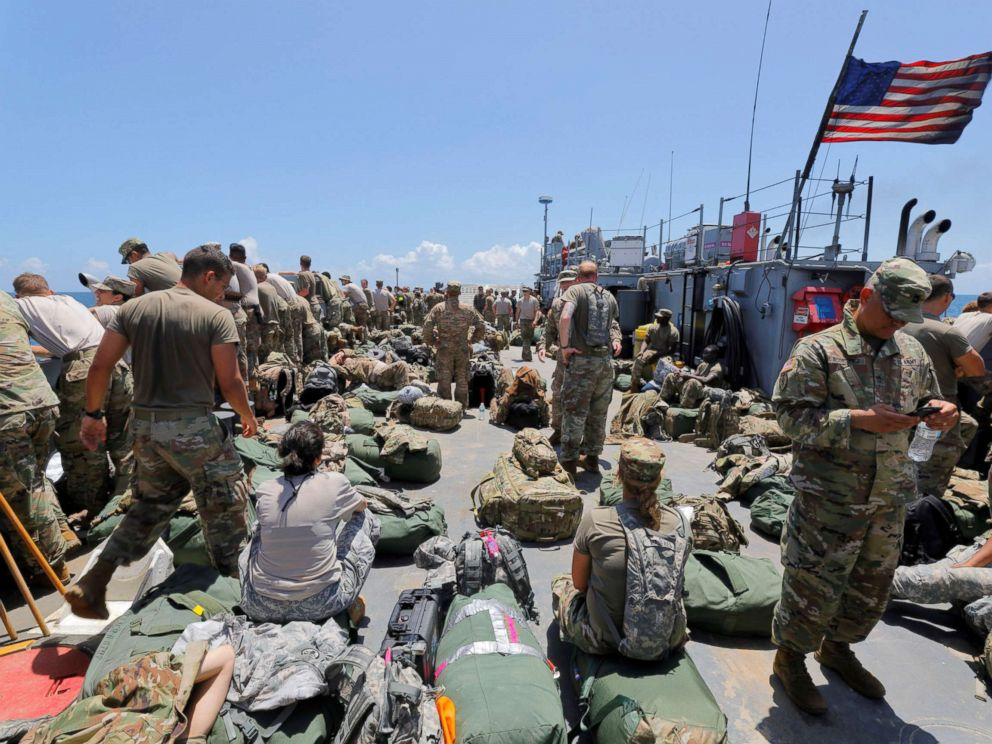 PHOTO: The deck of a U.S. Navy landing craft is crowded with Army soldiers and their belongings as they are evacuated in advance of Hurricane Maria, off St. Thomas shore, U.S. Virgin Islands, Sept. 17, 2017.