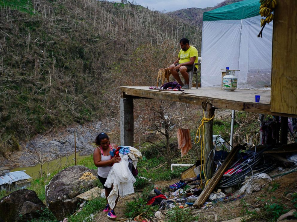 PHOTO: Yadira Sortre and William Fontan Quintero clean their house, destroyed by Hurricane Maria in in Morovis, Puerto Rico, Oct. 1, 2017.