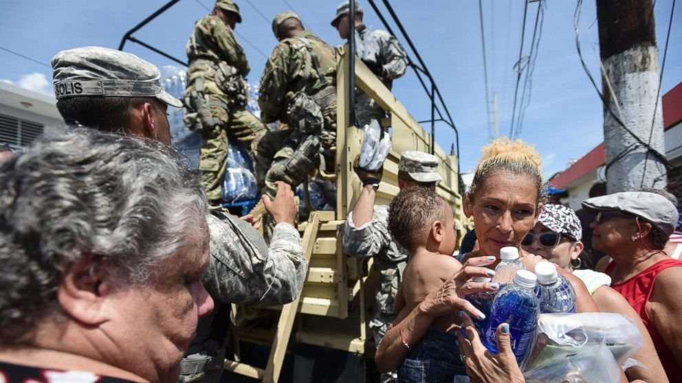 National Guard Soldiers arrive at Barrio Obrero in Santurce to distribute water and food among those affected by the passage of Hurricane Maria, in San Juan, Puerto Rico, Sept. 24, 2017.