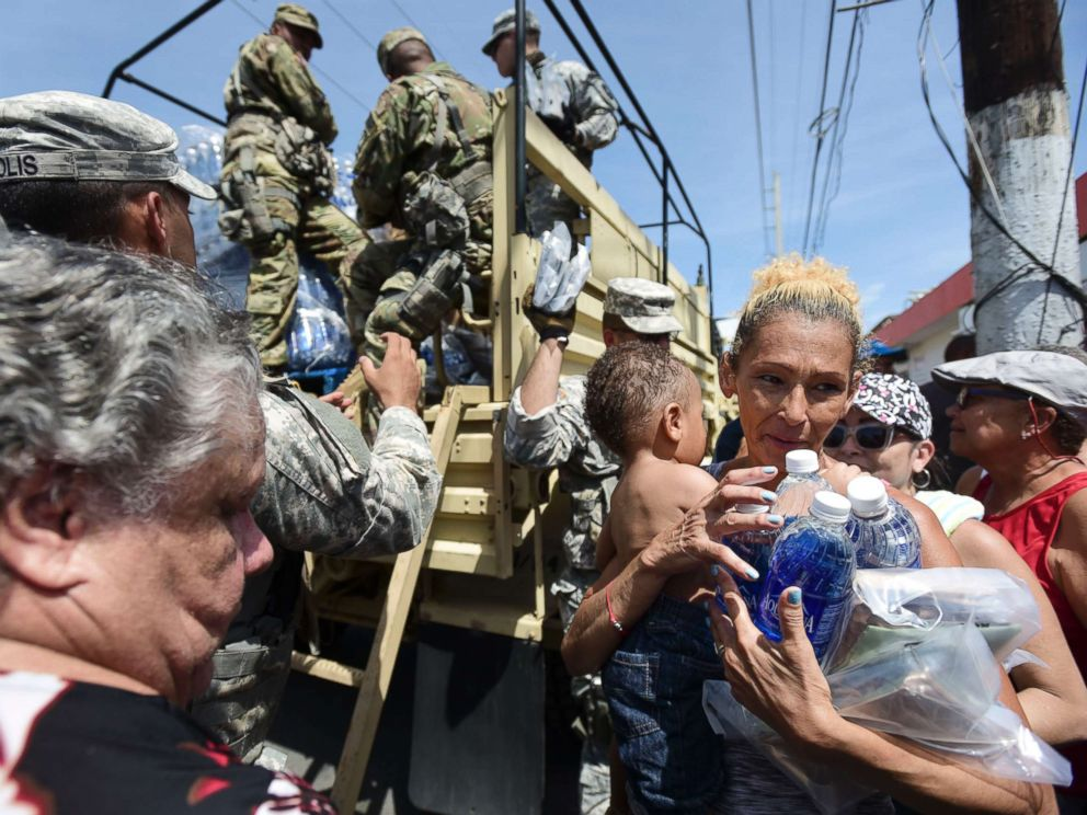 PHOTO: National Guard Soldiers arrive at Barrio Obrero in Santurce to distribute water and food among those affected by the passage of Hurricane Maria, in San Juan, Puerto Rico, Sept. 24, 2017.