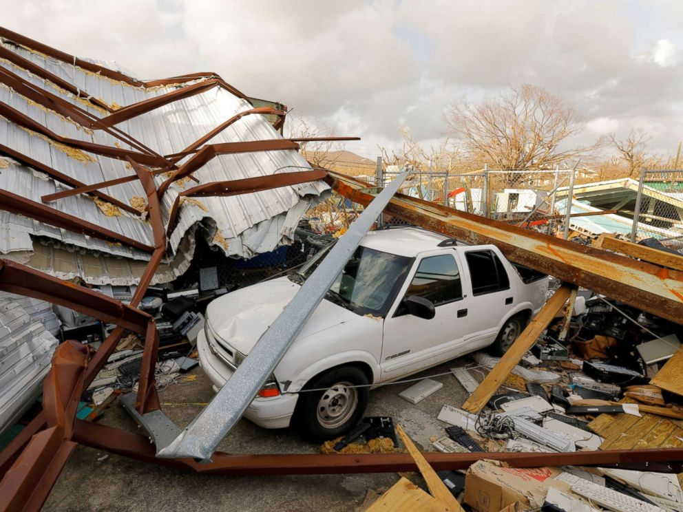 PHOTO: A car is seen crushed by steel beams and roofing that was mangled in the aftermath of Hurricane Maria at a recycling and waste management center in St. Croix, U.S. Virgin Islands, Sept. 27, 2017.