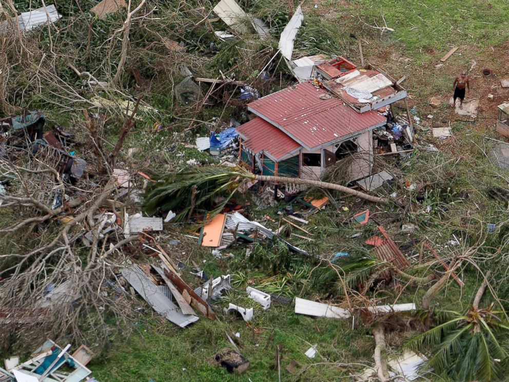 PHOTO: A man stands outside a destroyed home in this aerial photo from a Marine Corps MV-22 Osprey surveying the aftermath from Hurricane Maria in St. Croix, U.S. Virgin Islands, Sept. 21, 2017.