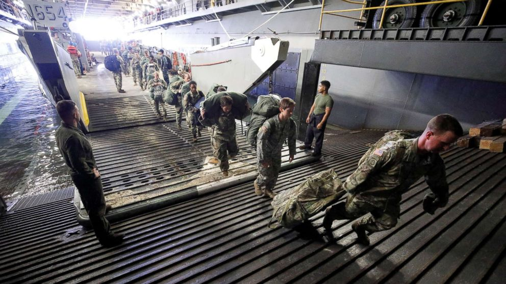 The Army's 602nd Area Support Medical Company boards the U.S.S. Kearsarge aircraft carrier from a Navy landing craft during their evacuation from the U.S. Virgin Islands in advance of Hurricane Maria, Sept. 17, 2017.