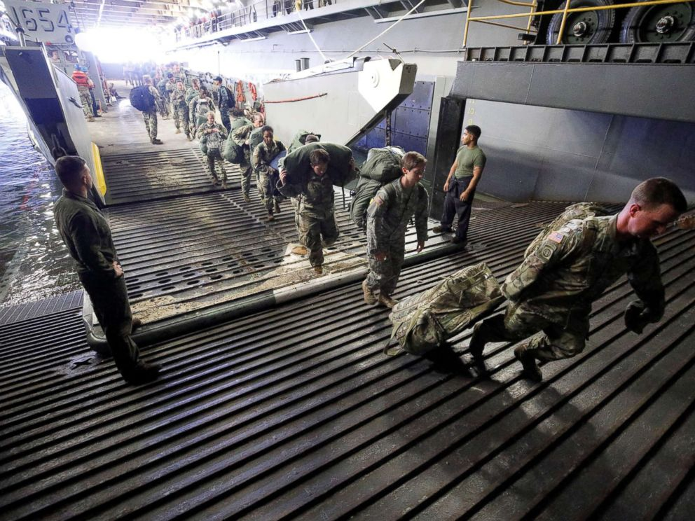 PHOTO: The Armys 602nd Area Support Medical Company boards the U.S.S. Kearsarge aircraft carrier from a Navy landing craft during their evacuation from the U.S. Virgin Islands in advance of Hurricane Maria, Sept. 17, 2017.