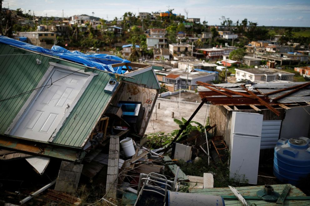Houses damaged or destroyed by Hurricane Maria stand at the squatter community of Villa Hugo in Canovanas, Puerto Rico, Dec. 11, 2017.