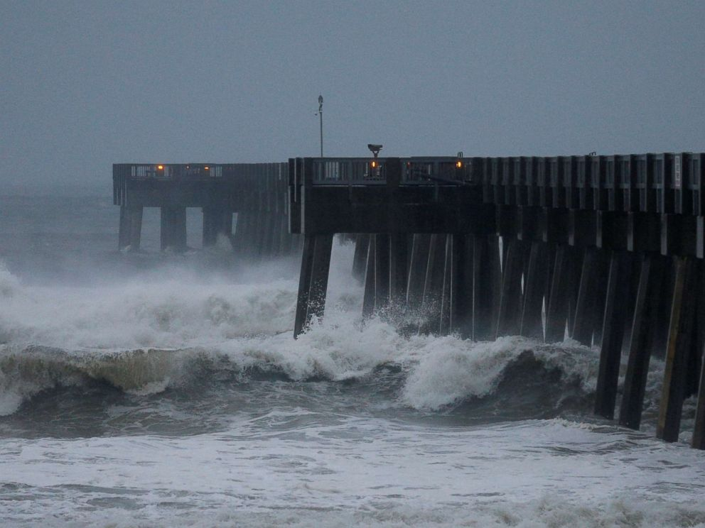 PHOTO: Waves crash along a pier as Hurricane Michael approaches Panama City Beach, Fla. Oct. 10, 2018.