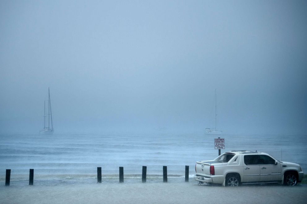 PHOTO: A car is seen in a parking lot while flooding begins as Hurricane Michael approaches, Oct. 10, 2018 in Panama City, Fla.