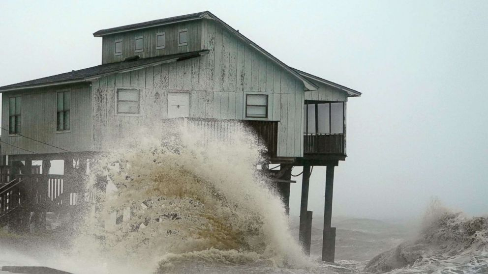 Waves take over a house as Hurricane Michael comes ashore in Alligator Point, Fla., Oct. 10, 2018.