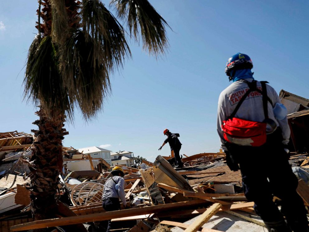 PHOTO: Members of a South Florida urban search and rescue team sift through a debris pile for survivors of Hurricane Michael in Mexico Beach, Fla., Oct. 14, 2018.