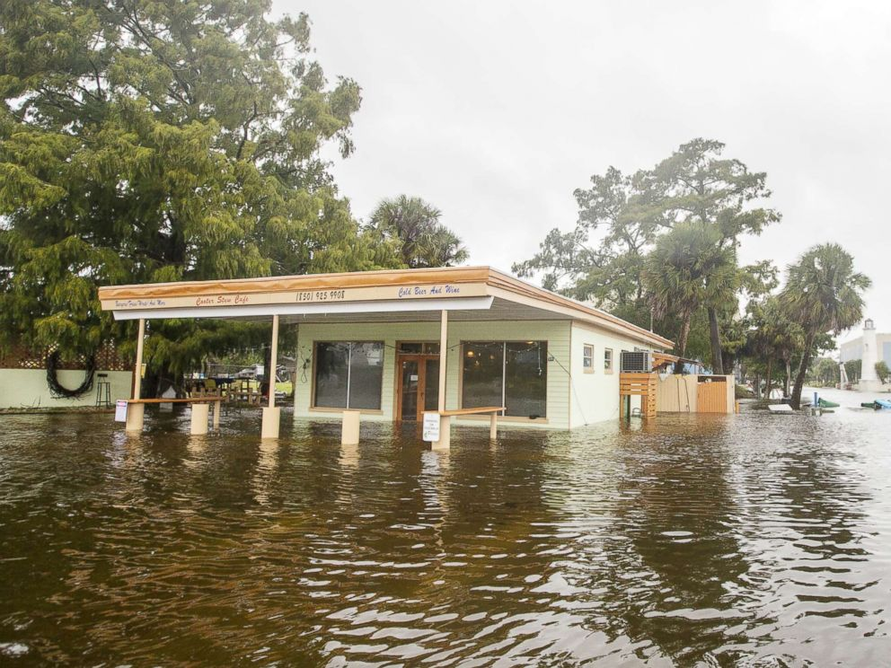 PHOTO: The Cooter Stew Cafe starts taking water in the town of Saint Marks as Hurricane Michael pushes the storm surge up the Wakulla and Saint Marks Rivers which come together here on Oct. 10, 2018, in Saint Marks, FLa.