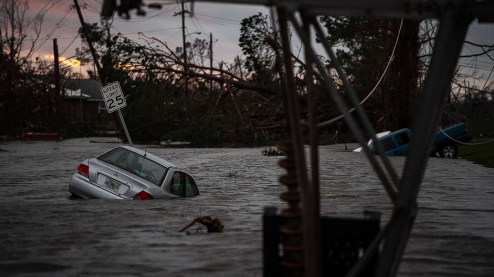 A car is seen caught in flood water after category 4 Hurricane Michael made land fall along the Florida panhandle, Oct. 10, 2018 in Panama City, Fla.