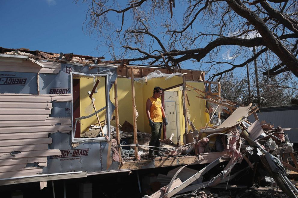 PHOTO: Volunteers help to clear debris left by Hurricane Michael at the severely-damaged Bay Oaks Village trailer park on Oct. 20, 2018 in Panama City, Fla.
