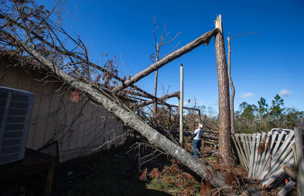 PHOTO: Ten days before Christmas and more than two months after Hurricane Michael made landfall, a resident stands outside his home that was hit by a snapped power pole in Panama City Beach, Fla., Dec. 15, 2018.