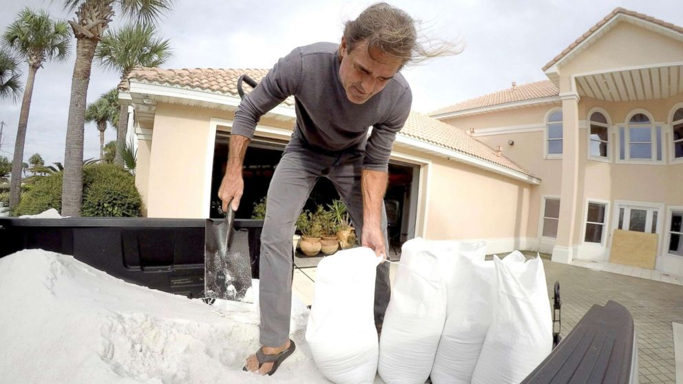 Rick Johnson fills sand bags, Oct. 9, 2018, at his Okaloosa Island home in Fort Walton Beach, Fla., in preparation for Hurricane Michael.
