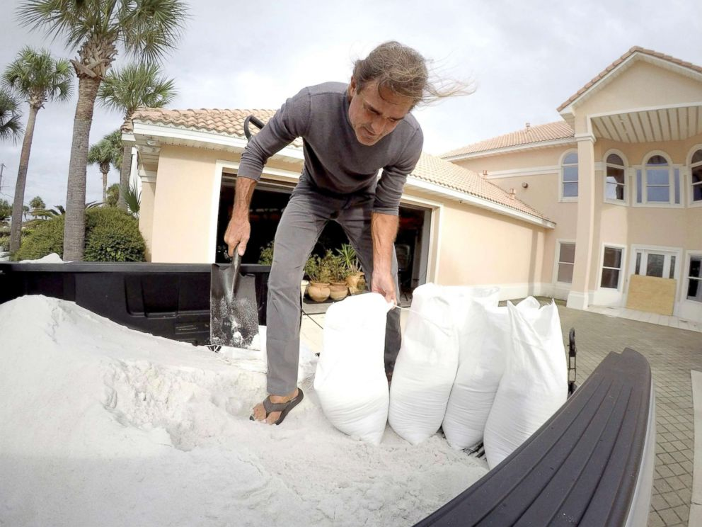 PHOTO: Rick Johnson fills sand bags, Oct. 9, 2018, at his Okaloosa Island home in Fort Walton Beach, Fla., in preparation for Hurricane Michael.