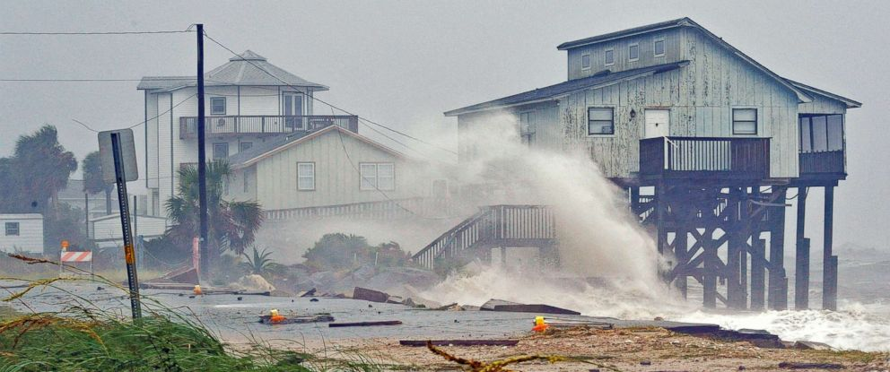 PHOTO: Waves crash on stilt houses along the shore due to Hurricane Michael at Alligator Point in Franklin County, Fla., Oct. 10, 2018.