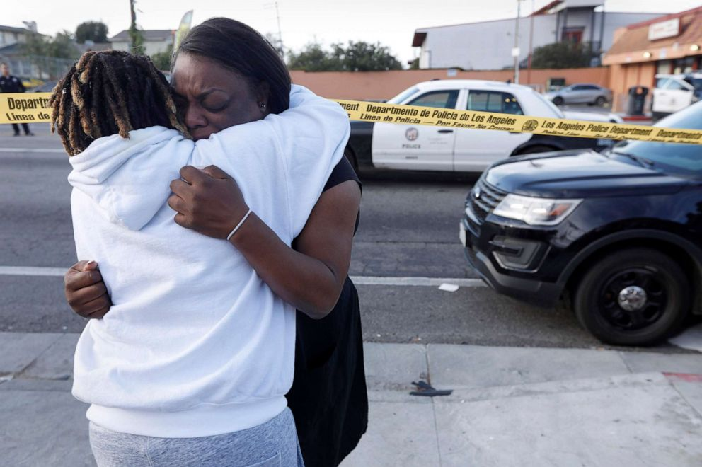 PHOTO: Im telling you, that was my friend. My friends dead. He was my childhood friend, said Marquesa Lawson, 34, left, over the shooting of rapper Nipsey Hussle who was killed in a shooting outside his store, March 31, 2019 in Los Angeles.