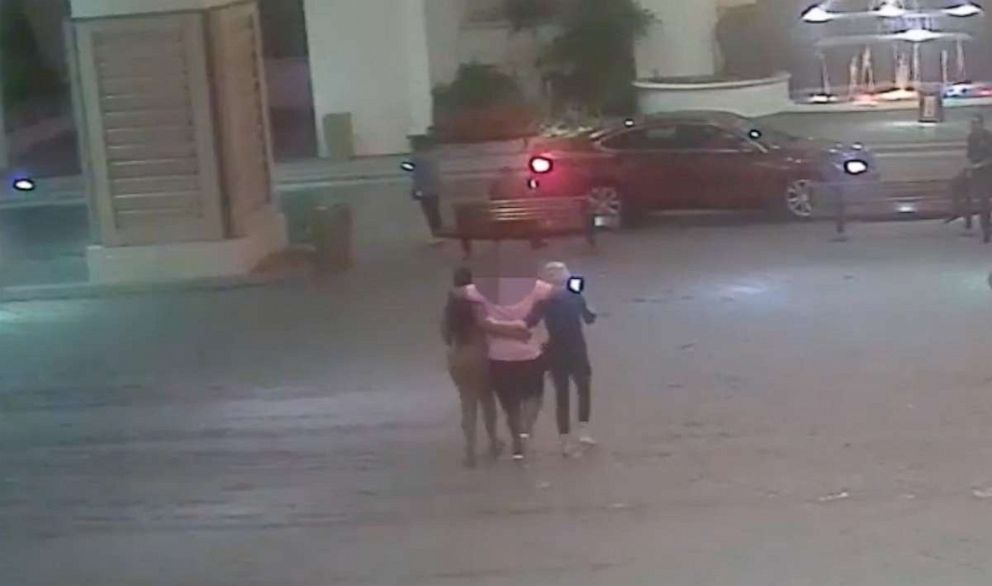 PHOTO: Surveillance video shows the women escorting the victim to a vehicle outside the casino.
