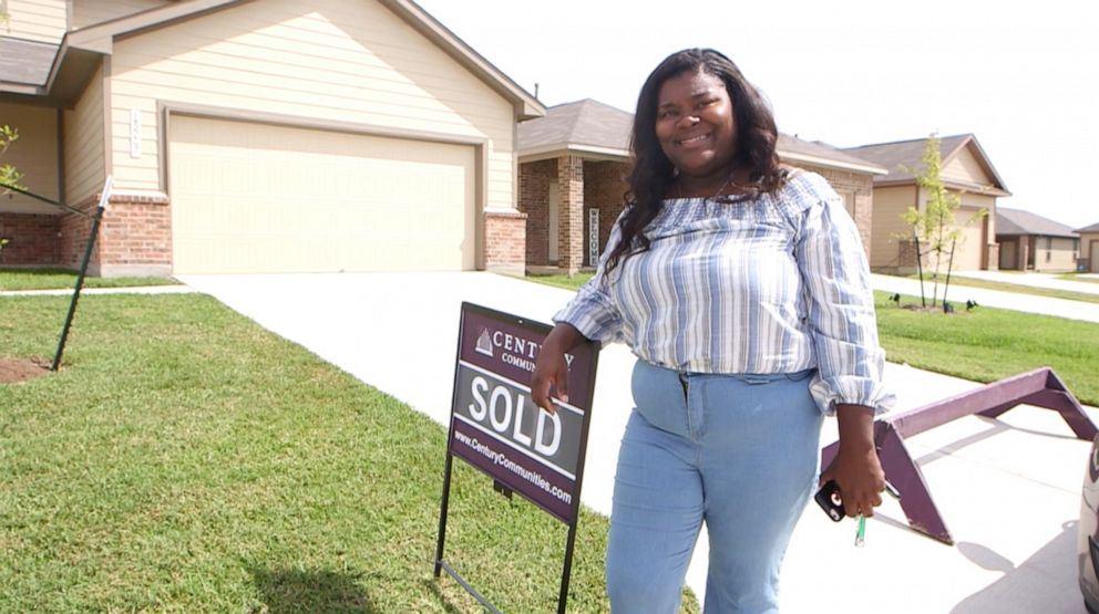 PHOTO: Iashia Nelson poses next to a sold sign in front of the house she hopes to close on by the end of September 2019.