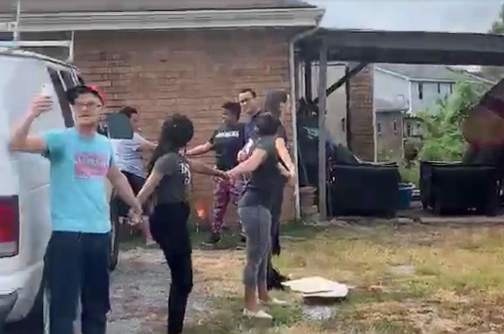 PHOTO: Neighbors formed a human chain on Monday, July 22 to prevent the arrest of a man outside his home near Nashville.