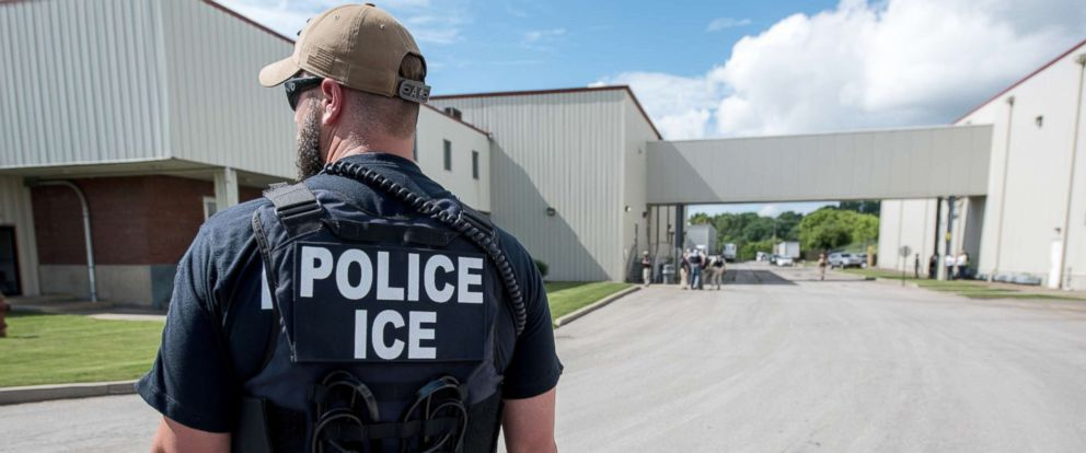 PHOTO: US Immigration and Customs Enforcements (ICE) special agent prepare to arrest alleged immigration violators at Fresh Mark, Salem, June 19, 2018.