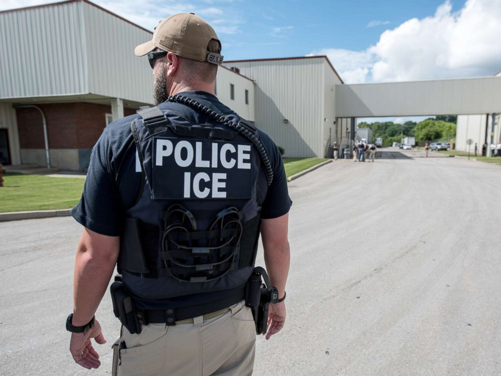PHOTO: US Immigration and Customs Enforcements (ICE) special agent prepare to arrest alleged immigration violators at Fresh Mark, Salem, June 19, 2018.