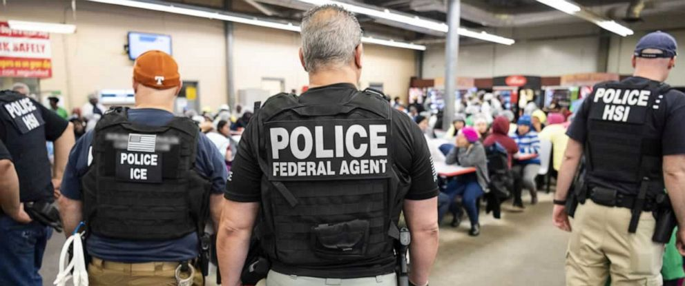 PHOTO: Officers from Immigration and Customs Enforcement look on after executing search warrants and making some arrests at an agricultural processing facility in Canton, Miss., in this photo released by ICE on Aug. 7, 2019.