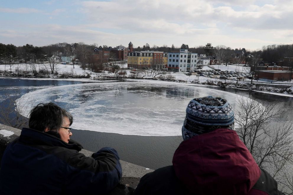 PHOTO: Onlookers watch a large, circular ice floe spinning slowly in the Presumpscot River in Westbrook, Maine, Jan. 16, 2019.
