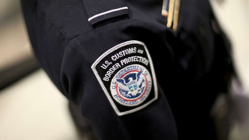 An officer is pictured in his U.S. Customs and Border Protection uniform.
