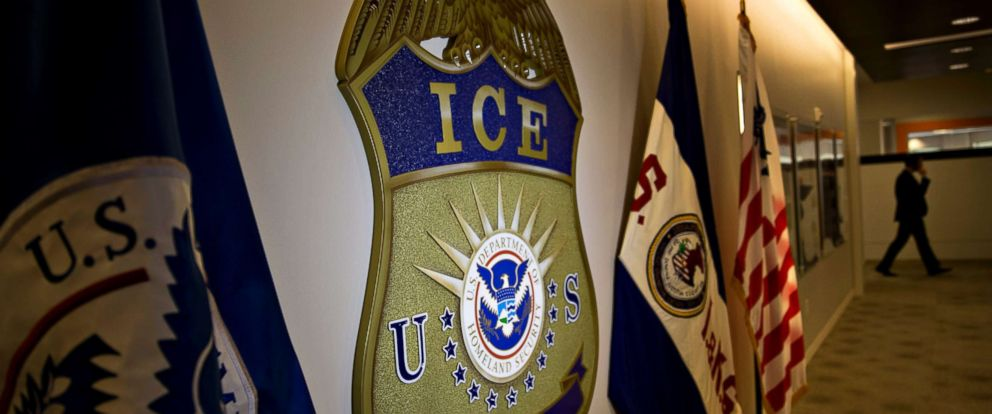 PHOTO: The U.S. Immigration and Customs Enforcement (ICE) seal hangs on a wall at the headquarters in Washington, D.C. on Nov. 20, 2014.