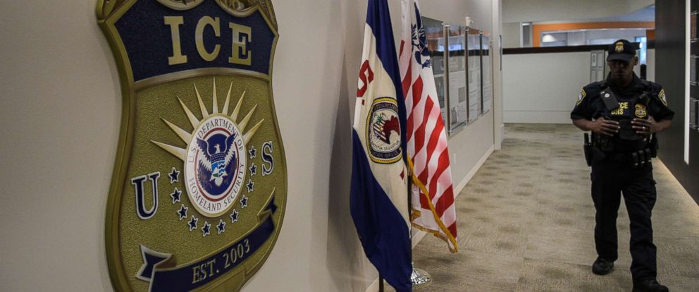 PHOTO: A law enforcement officer walks past ICE logo on May 11, 2017, at the U.S. Immigration and Customs Enforcement headquarters in Washington, D.C.