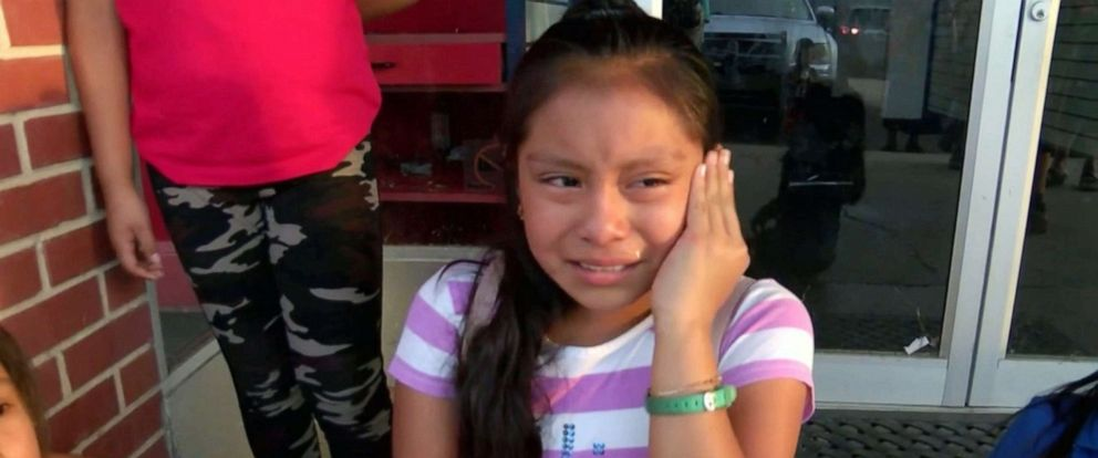 PHOTO: Magdalena Gomez Gregorio, 11, cries while talking to reporters about her father, who was arrested by ICE agents during a raid in Mississippi on Aug. 7, 2019.