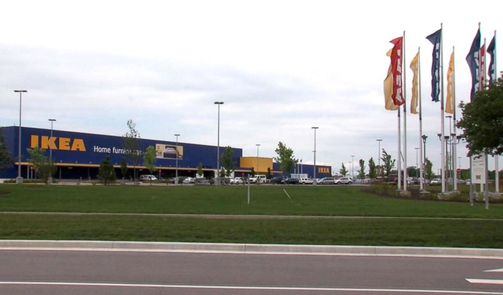 PHOTO: Cars are parked outside an IKEA store in Fishers, Ind., where a boy fired a loaded gun that he found in a couch on June 25, 2018.