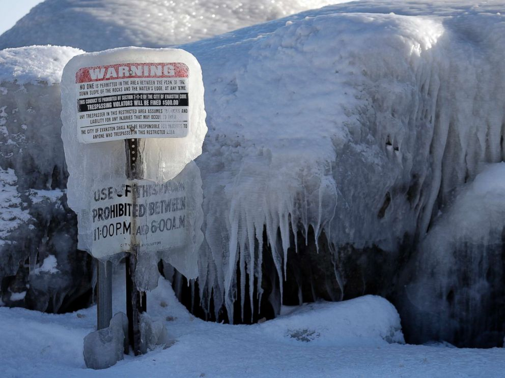 PHOTO: A warning sign is covered by ice at Clark Square park in Evanston, Ill., Jan. 30, 2019.