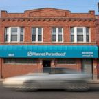 A motorist passes a Planned Parenthood clinic, May 18, 2018, in Chicago.
