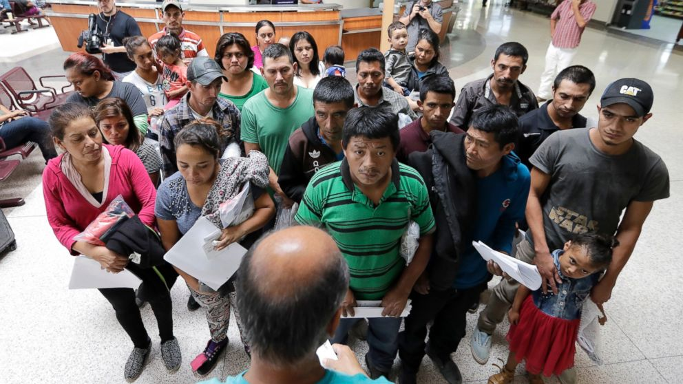 Immigrants listen to instructions from a volunteer inside the bus station after they were processed and released by U.S. Customs and Border Protection, Friday, June 22, 2018, in McAllen, Texas.