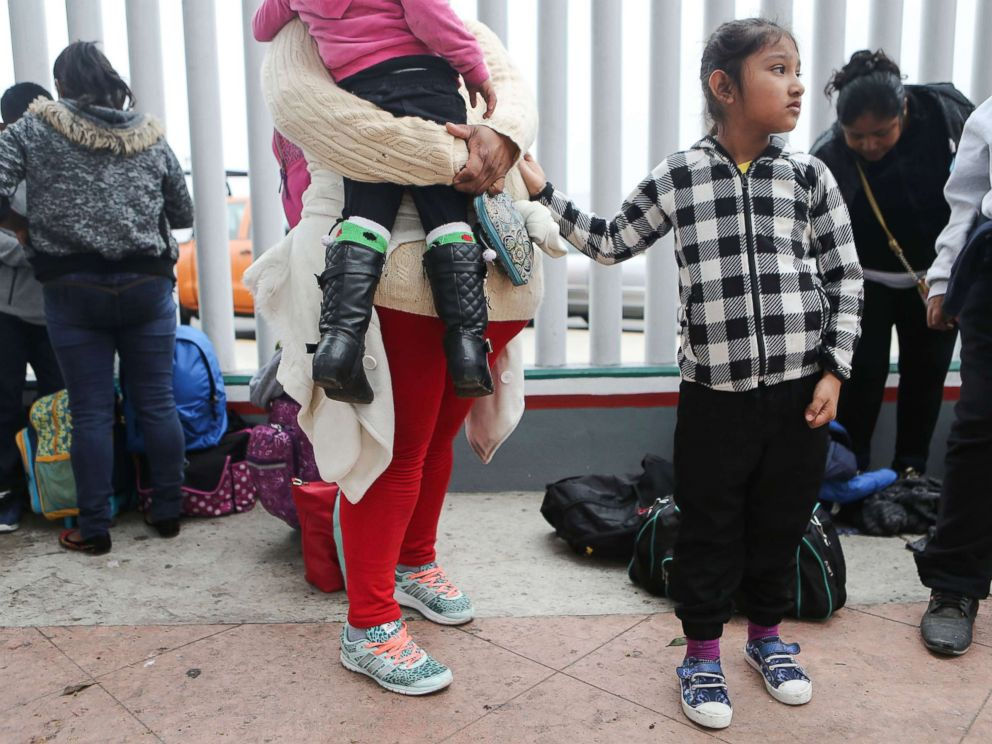 PHOTO: A migrant mother waits with her two daughters on their way to the port of entry to ask for asylum in the U.S., June 21, 2018, in Tijuana, Mexico.