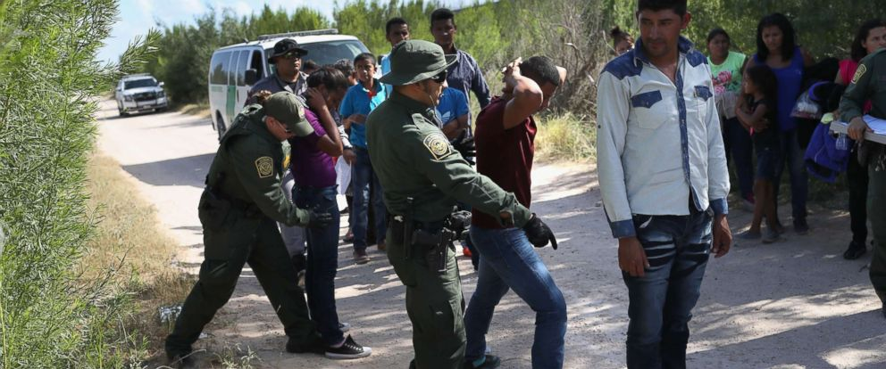 PHOTO: Border Patrol agents take a group of Central American asylum seekers into custody on June 12, 2018 near McAllen, Texas.