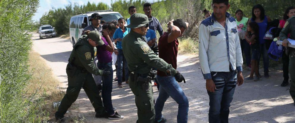PHOTO: Border Patrol agents take a group of Central American asylum seekers into custody on June 12, 2018 near McAllen, Texas.