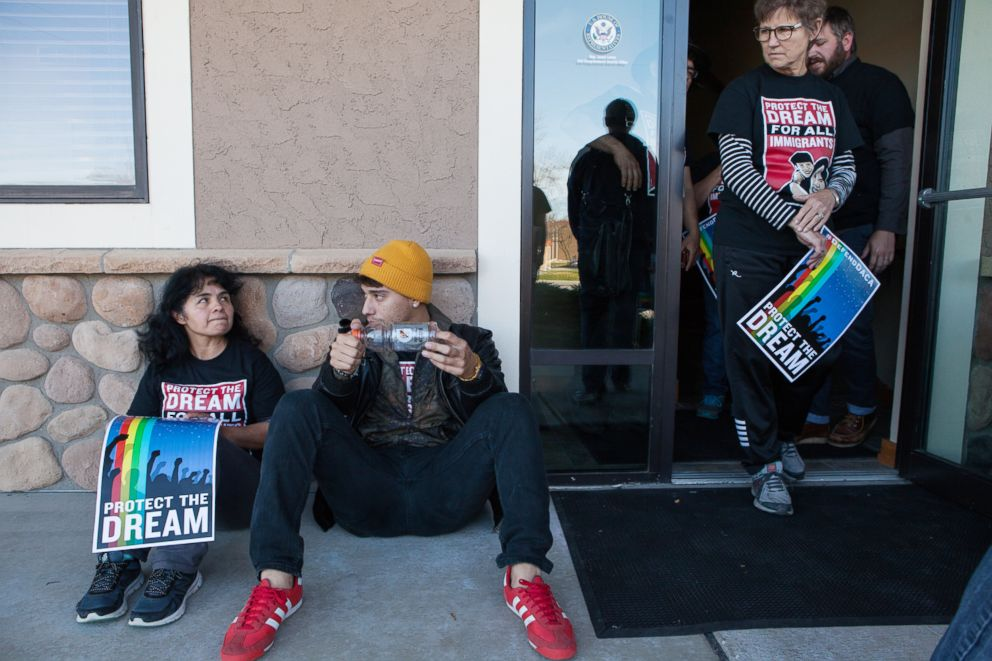 PHOTO: Alvarez talks with a member of her organization after being locked out of both Congressmen Jason Lewis and Erik Paulsens office during attempted sit-in protests.