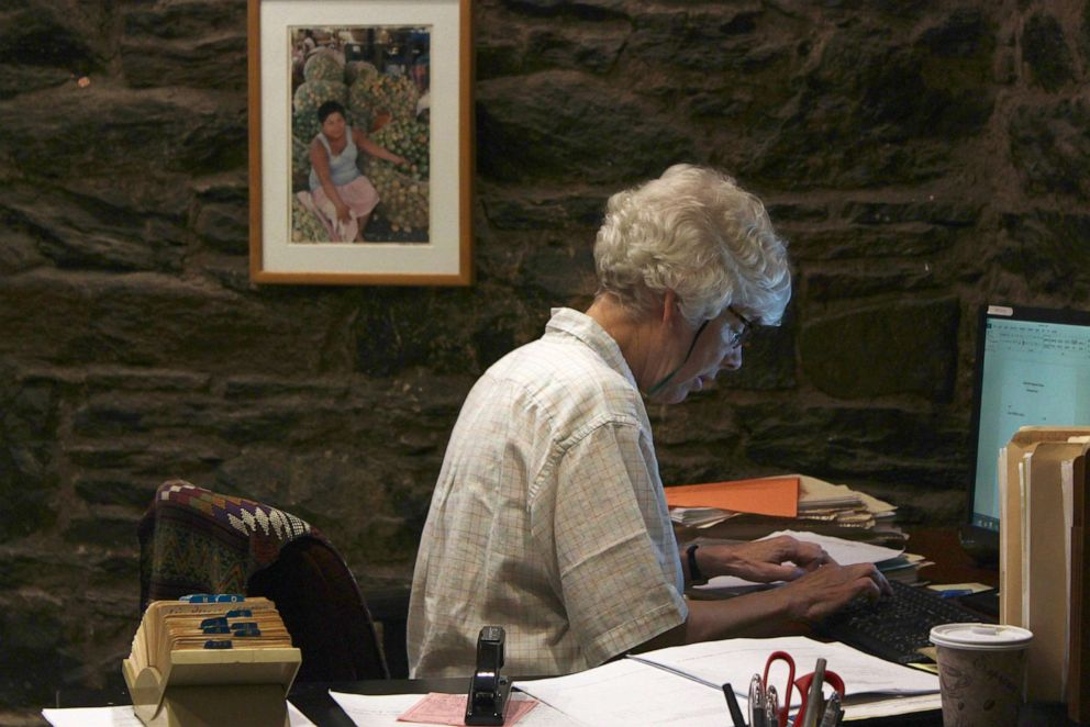 PHOTO: Anne Pilsbury, Executive Director at Central American Legal Assistance in Brooklyn, New York, works at her desk.