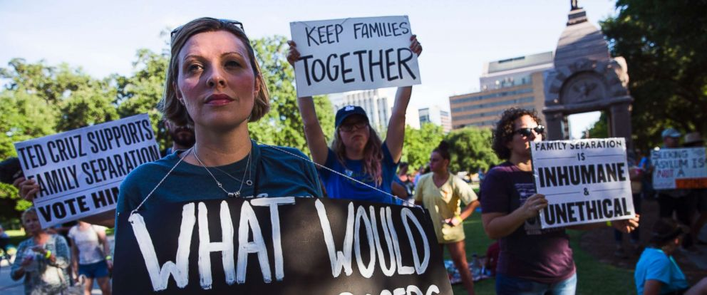 PHOTO: Demonstrators gather to protest against the separation of immigrant families at the border in Austin, on June 14, 2018, in Austin, Texas.