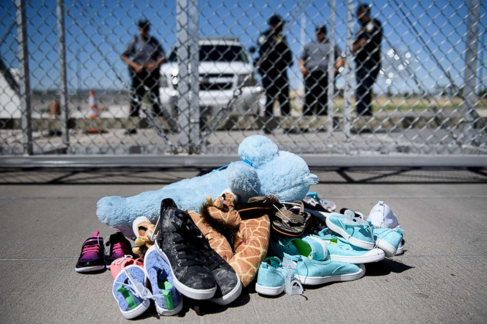 PHOTO: This June 21, 2018 file photo shows security personal standing before shoes and toys left at the Tornillo Port of Entry in Tornillo, Texas, where minors crossing the border without proper papers have been housed after being separated from adults.