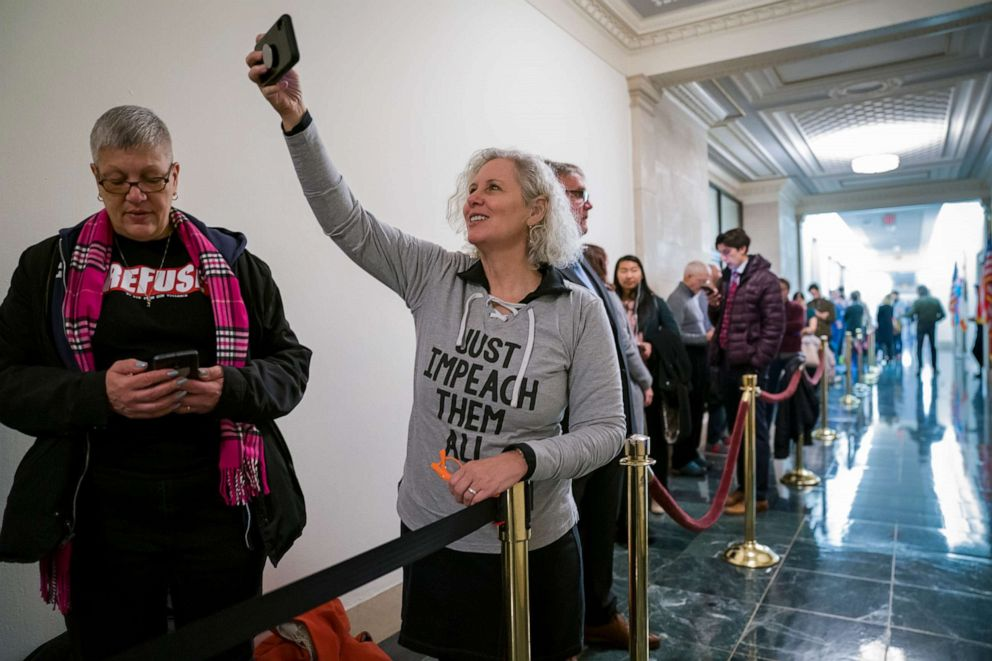 PHOTO: Jennifer Fisher, center, and Cathy Marino-Thomas, left, both of New York City, wait in line to attend a hearing by the House Judiciary Committee on Capitol Hill in Washington, Dec. 4, 2019.
