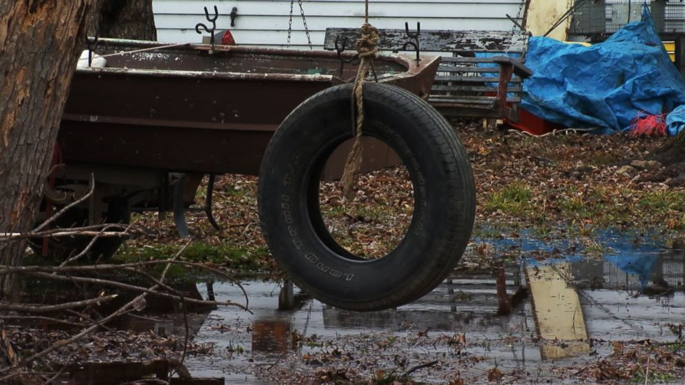 PHOTO: A tire swing sits outside of a burned house after three children died and a mother and two siblings escaped a fire in Tell City, Ind., Dec. 28, 2018.