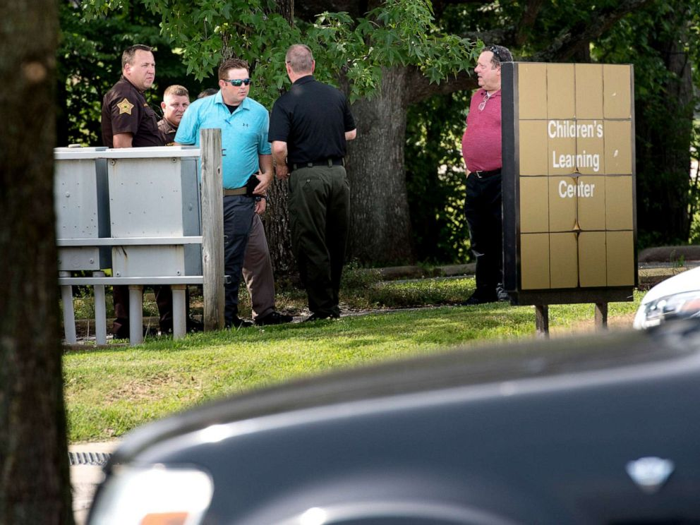 PHOTO: Members of the Vanderburgh County Sheriffs Office investigate the death of a child left in a hot car at the University of Southern Indianas Childrens Learning Center, July 9, 2019.