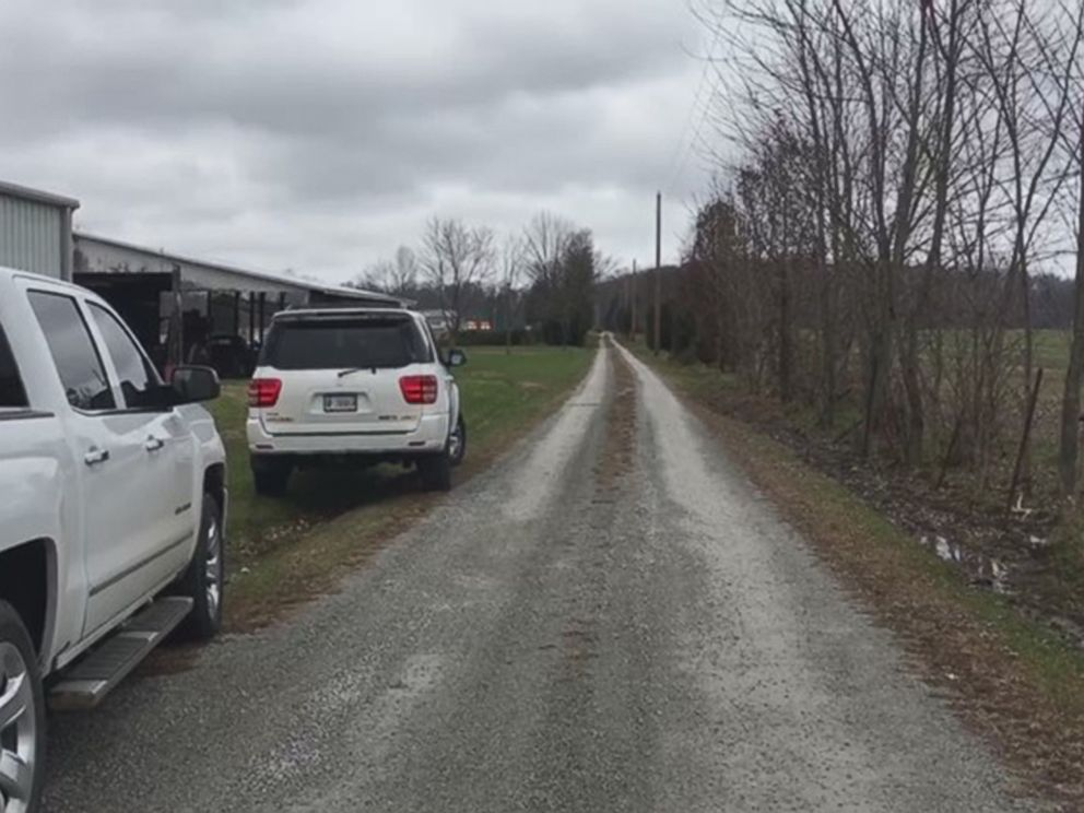PHOTO: Cars are parked by a road in a rural, wooded area of southern Indiana near the scene of a small plane crash, Nov. 30, 2018.