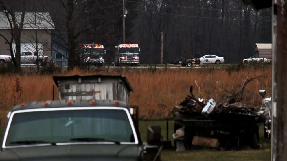 Emergency vehicles sit near the site of a small plane crash in a rural, wooded area of southern Indiana, Nov. 30, 2018.